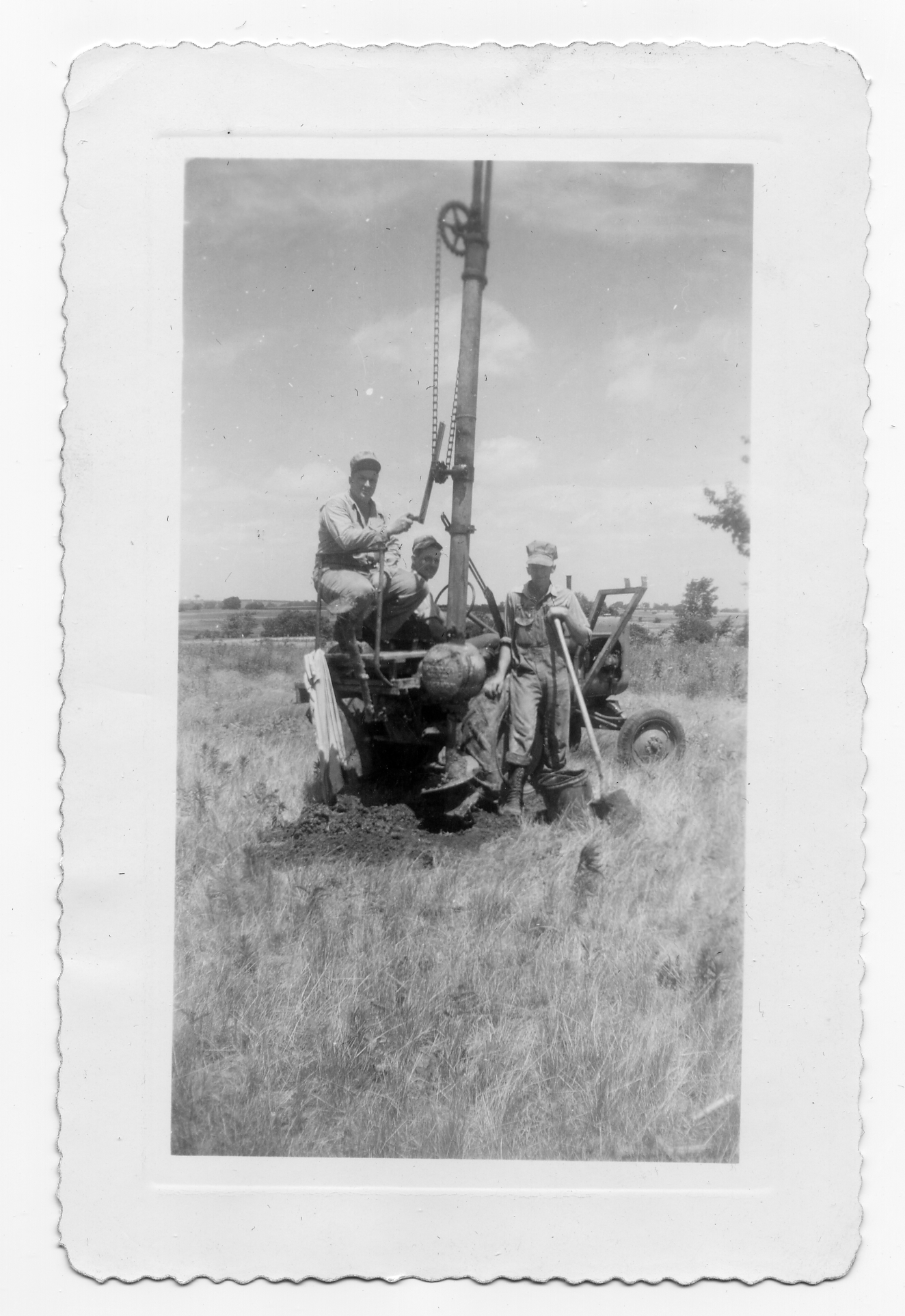 Linemen setting some of the first power poles